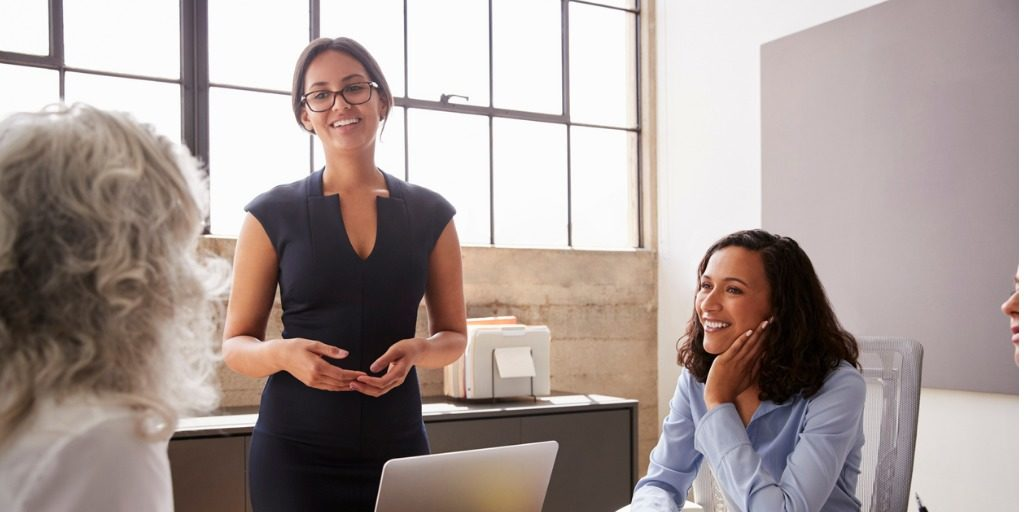 female-manager-in-glasses-addressing-businesswomen-in-meeting-landscape